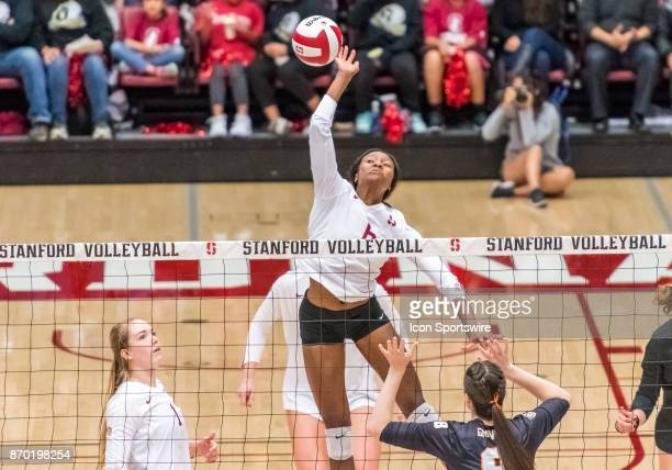 Stanford middle blocker Tami Alade sends a hard volley over the net for a point during the regular season game between the Oregon State Beavers...