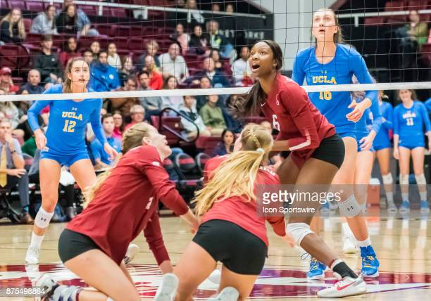 Stanford middle blocker Tami Alade watches the ball fly to back court after a successful dig by Stanford outside hitter Kathryn Plummer and Stanford...