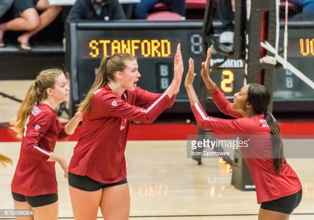 Stanford opposite Merete Lutz and Stanford middle blocker Tami Alade give each other fives after a score during the regular match between the UCLA...