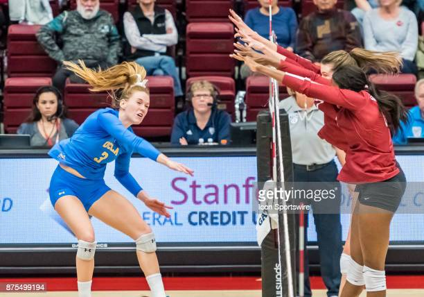 Stanford opposite Merete Lutz and Stanford middle blocker Tami Alade get a block on a hit by UCLA outside hitter Reily Buechler during the regular...