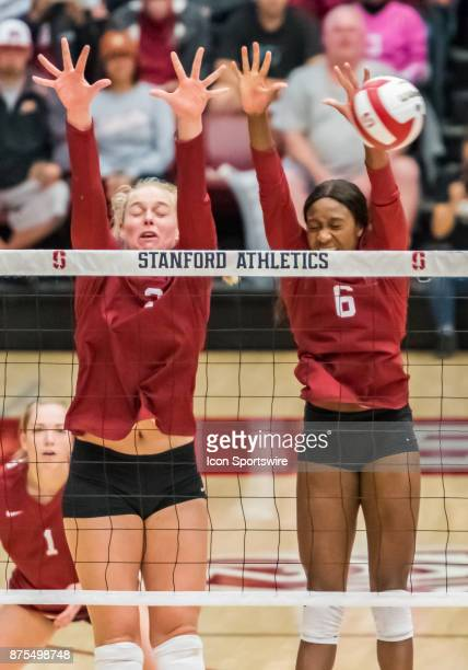 Stanford outside hitter Kathryn Plummer and Stanford middle blocker Tami Alade let a ball slip by their block attempt during the regular match...