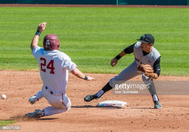 Stanford pitcher Quinn Brodey slides into second while Long Beach St infielder Laine Huffman waits for a throw during the regular season game between...