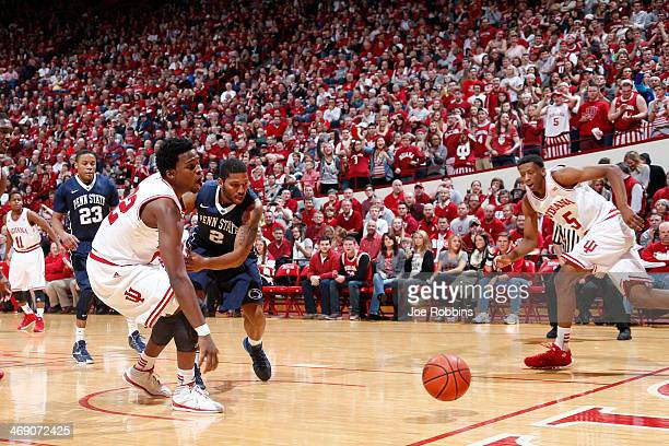 Stanford Robinson of the Indiana Hoosiers loses the ball while driving to the basket against DJ Newbill of the Penn State Nittany Lions during the...