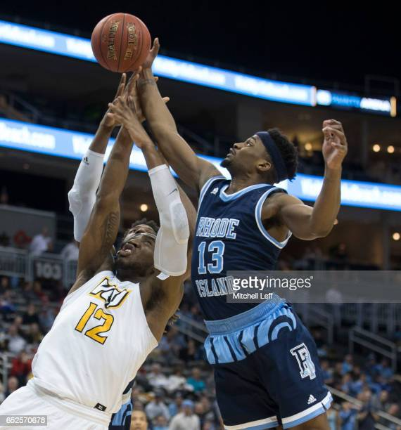 Stanford Robinson of the Rhode Island Rams and Mo AlieCox of the Virginia Commonwealth Rams fight for the ball in the Championship game of the men's...