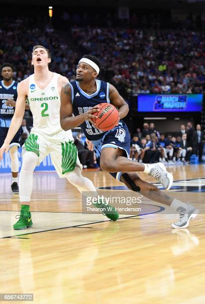 Stanford Robinson of the Rhode Island Rams drives to the basket on Casey Benson of the Oregon Ducks during the second round of the 2017 NCAA Men's...