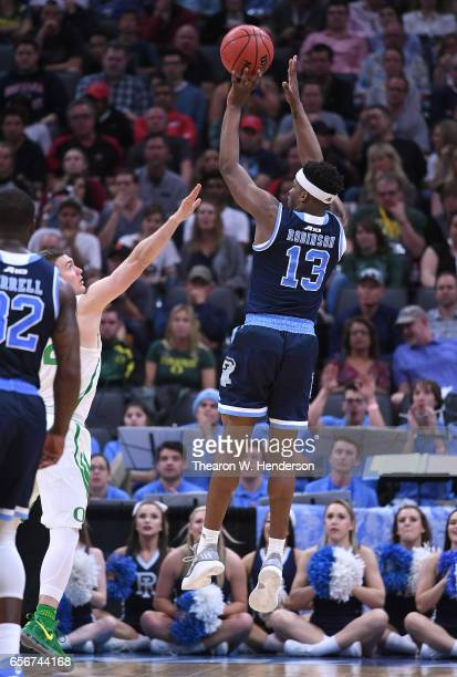 Stanford Robinson of the Rhode Island Rams shoots over Casey Benson of the Oregon Ducks during the second round of the 2017 NCAA Men's Basketball...