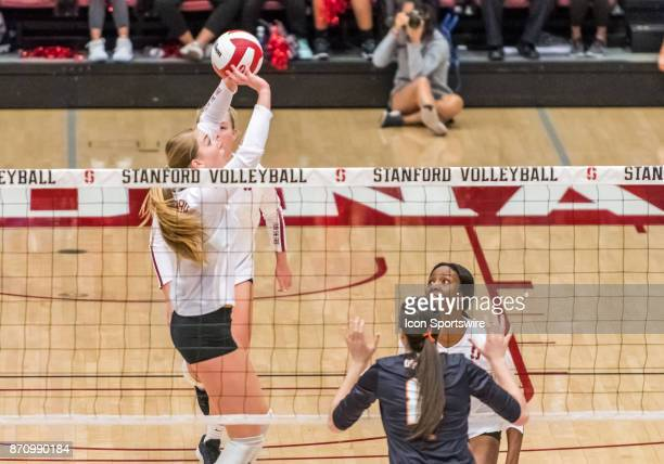 Stanford setter Jenna Gray sets a ball for Stanford middle blocker Tami Alade during the regular season game between the Oregon State Beavers verses...