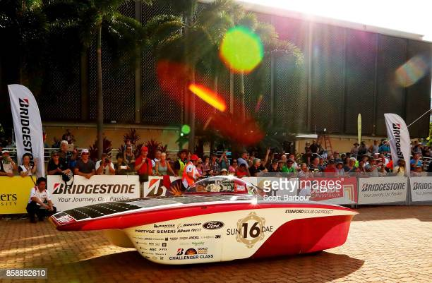 Stanford Solar Car Project vehicle 'Sundae' from the United States of America leaves the start line as they begin racing on Day 1 of the 2017...
