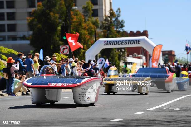 Stanford Solar Car Project vehicle 'Sundae' from the United States of America competes during a street parade for the 2017 Bridgestone World Solar...