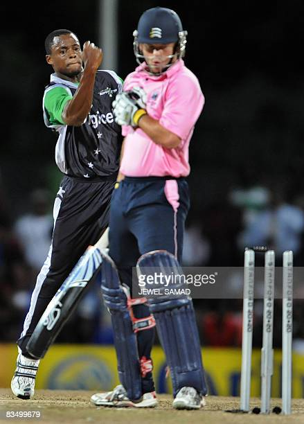 Stanford Superstars cricketer Daren Powell celebrates after bowling out Middlesex's batsman Ed Joyce during the Stanford Twenty20 Super Series match...
