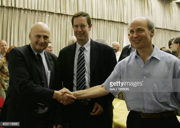 Stanford University professor Roger Kornberg the winner of the 2006 Nobel chemistry prize shakes hand with the president of the Hebrew University in...