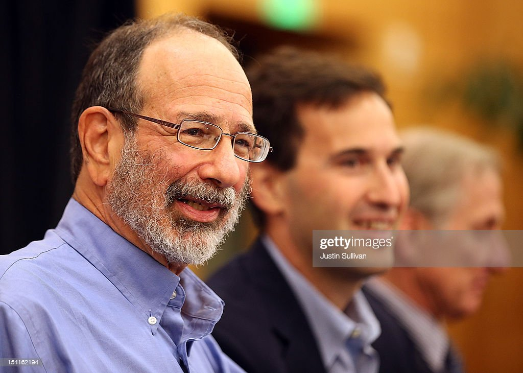 Stanford visiting professor Alvin Roth (L) looks on during a press conference announcing his Nobel Prize in economics on October 15, 2012 in Stanford, California. Americans Alvin Roth and Lloyd Shapley were awarded the prize for their work on market design and matching theory.