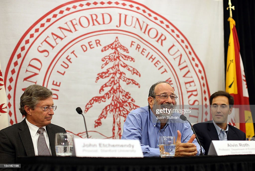 Stanford visiting professor Alvin Roth (C) speaks during a press conference announcing his Nobel Prize in economics as Stanford Provost John Etchemendy (L) and Stanford Department of Economics chair Johnathan Levine (R) listen on October 15, 2012 in Stanford, California. Americans Alvin Roth and Lloyd Shapley were awarded the prize for their work on market design and matching theory.