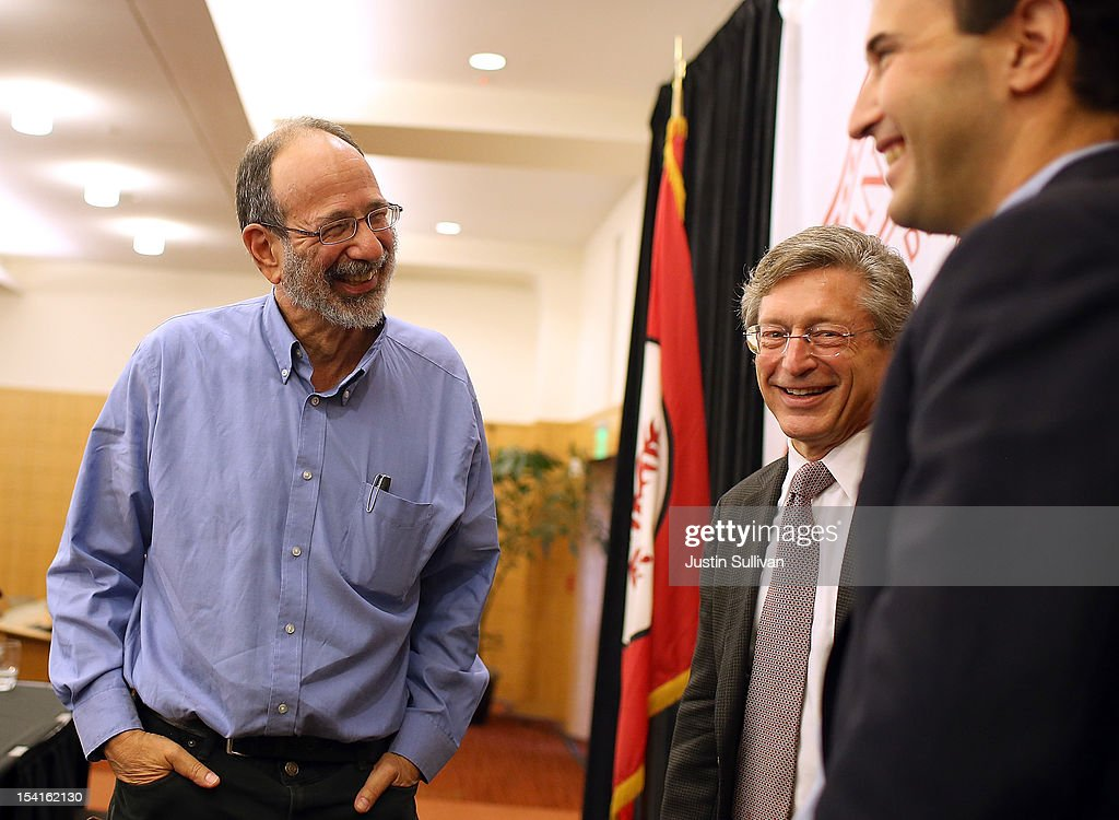 Stanford visiting professor Alvin Roth (L) talks with Stanford Provost John Etchemendy (C) and Stanford Department of Economics chair Johnathan Levine (R) during a press conference announcing his Nobel Prize in economics on October 15, 2012 in Stanford, California. Americans Alvin Roth and Lloyd Shapley were awarded the prize for their work on market design and matching theory.