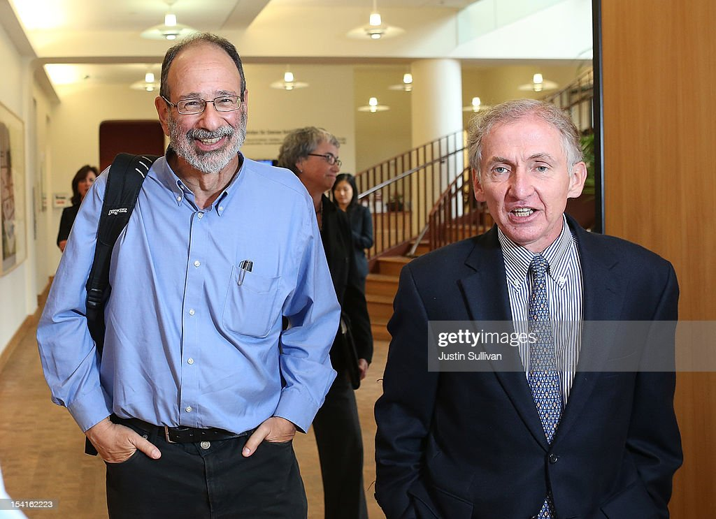 Stanford visiting professor Alvin Roth (L) walks with Stanford University Dean of the School of Humanities and Sciences Richard Saller before a press conference announcing Roth's Nobel Prize in economics on October 15, 2012 in Stanford, California. Americans Alvin Roth and Lloyd Shapley were awarded the prize for their work on market design and matching theory.