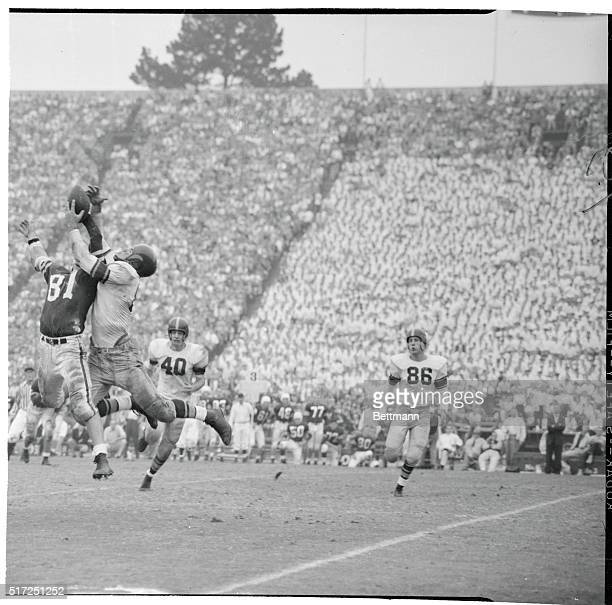 Stanford's Bob Gergen barely gets his hand on a ball thrown to him as USC's Leon Clarke claws the air trying to intercept during the third quarter...