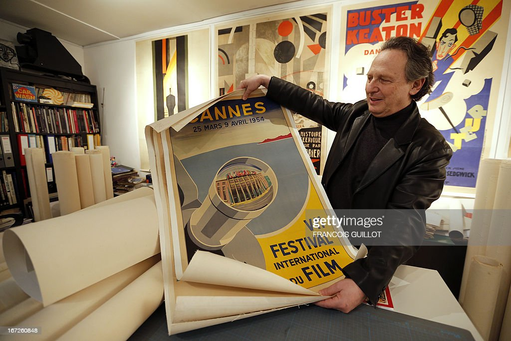 Stanislas Choko, a specialist of vintage cinema posters presents the original poster of the seventh edition of Cannes film festival, on April 23, 2013 in Paris, two days ahead of an auction of a movie posters' collection.