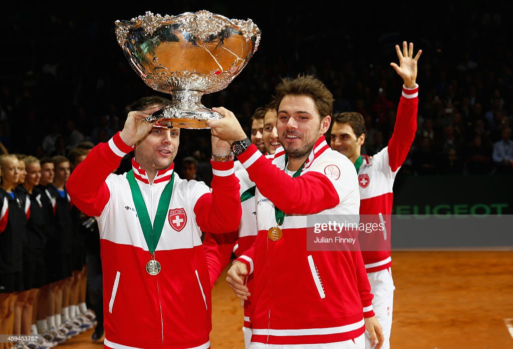 <a gi-track='captionPersonalityLinkClicked' href=/galleries/search?phrase=Stanislas+Wawrinka&family=editorial&specificpeople=557155 ng-click='$event.stopPropagation()'>Stanislas Wawrinka</a> of Switzerland and Captain Severin Luthi of Switzerland celebrate winning the Davis Cup against France during day three of the Davis Cup Tennis Final between France and Switzerland at the Stade Pierre Mauroy on November 23, 2014 in Lille, France.