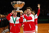 Stanislas Wawrinka of Switzerland and Captain Severin Luthi of Switzerland celebrate winning the Davis Cup against France during day three of the...