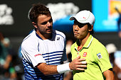 Stanislas Wawrinka of Switzerland and Kei Nishikori of Japan at the net after Wawrinka won their quarterfinal match during day 10 of the 2015...