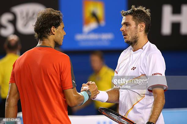 Stanislas Wawrinka of Switzerland and Rafael Nadal of Spain hug at the net after Wawrinka won their men's final match during day 14 of the 2014...