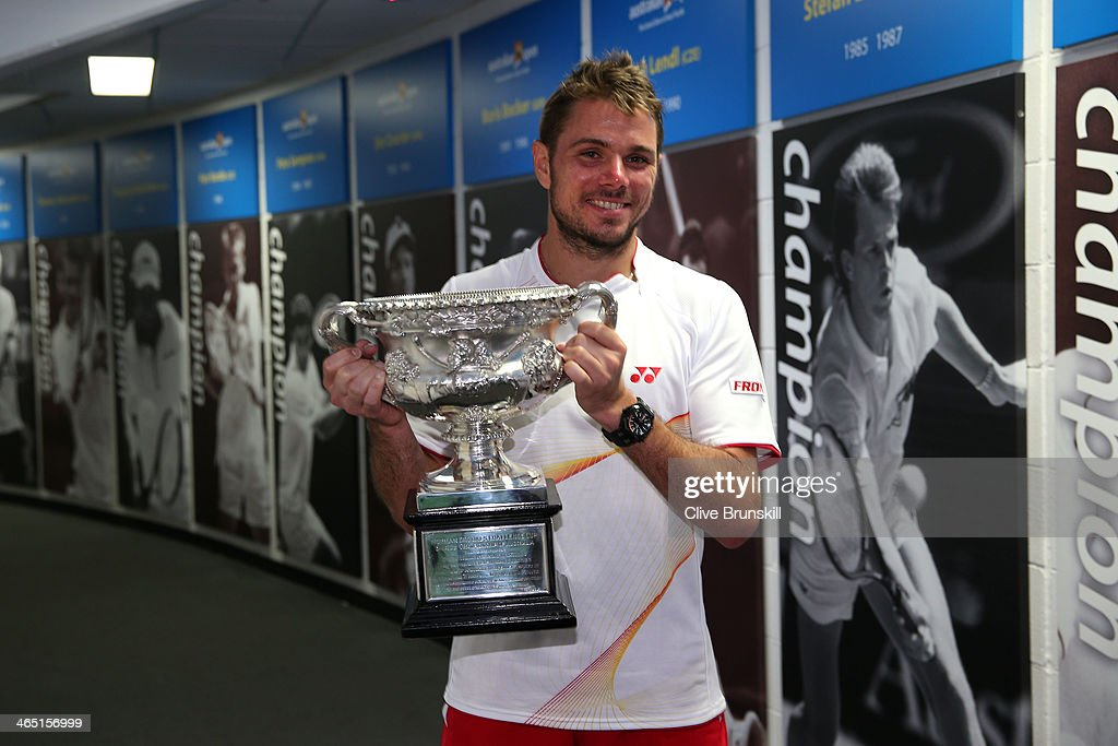 <a gi-track='captionPersonalityLinkClicked' href=/galleries/search?phrase=Stanislas+Wawrinka&family=editorial&specificpeople=557155 ng-click='$event.stopPropagation()'>Stanislas Wawrinka</a> of Switzerland carries the Norman Brookes Challenge Cup at the Walk of Champions after winning his men's final match against Rafael Nadal of Spain during day 14 of the 2014 Australian Open at Melbourne Park on January 26, 2014 in Melbourne, Australia.