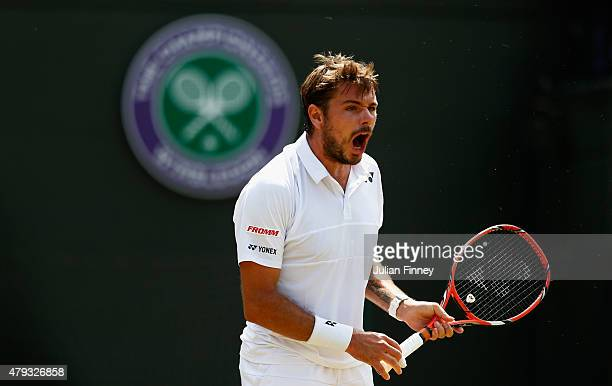 Stanislas Wawrinka of Switzerland celebrates a point in his Gentlemen's Singles Third Round match against Fernando Verdasco of Spain during day five...