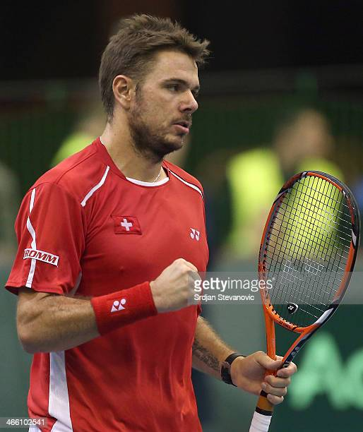 Stanislas Wawrinka of Switzerland celebrates after winning the first set against Dusan Lajovic of Serbia during day one of the Davis Cup match...