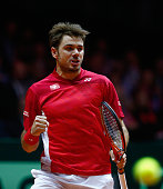 Stanislas Wawrinka of Switzerland celebrates breaking in the first set against JoWilfried Tsonga of France during day one of the Davis Cup Tennis...