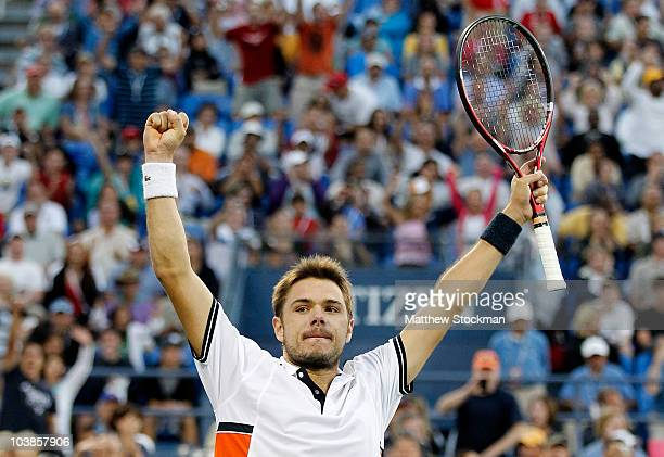 Stanislas Wawrinka of Switzerland celebrates match point against Andy Murray of Great Britain during the men's singles match on day seven of the 2010...
