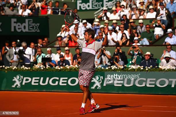 Stanislas Wawrinka of Switzerland celebrates match point in the Men's Singles Final against Novak Djokovic of Serbia on day fifteen of the 2015...