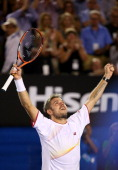 Stanislas Wawrinka of Switzerland celebrates winning championship point in his men's final match against Rafael Nadal of Spain during day 14 of the...