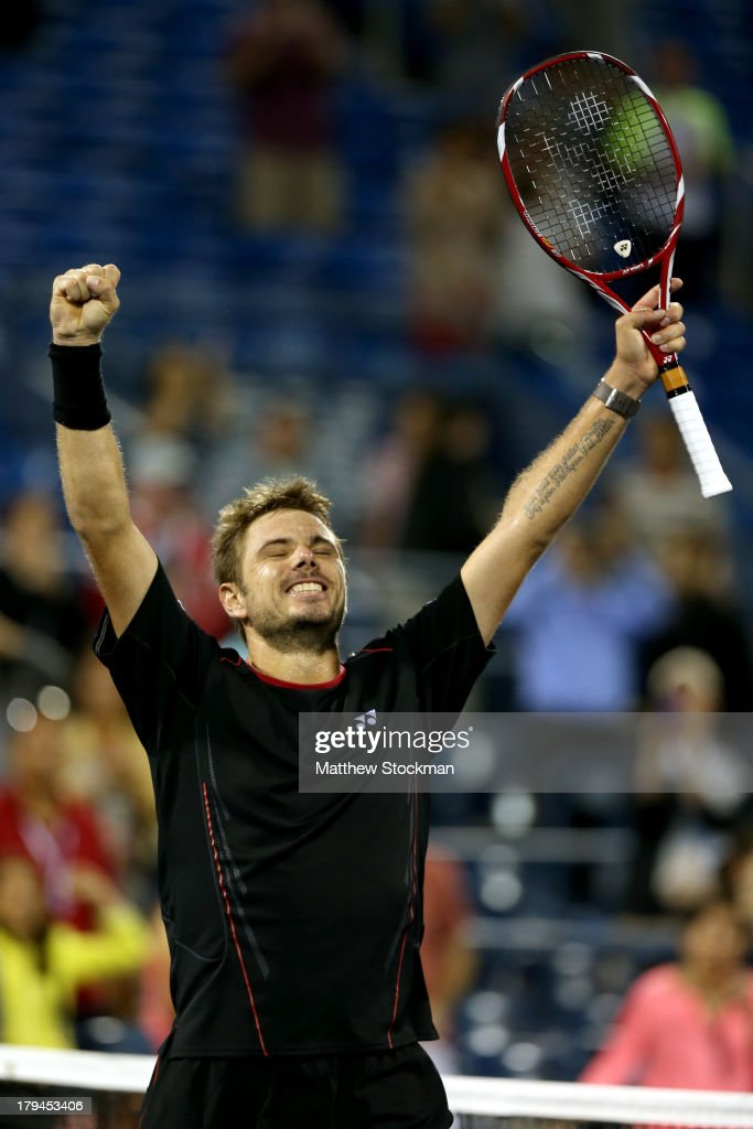 <a gi-track='captionPersonalityLinkClicked' href=/galleries/search?phrase=Stanislas+Wawrinka&family=editorial&specificpeople=557155 ng-click='$event.stopPropagation()'>Stanislas Wawrinka</a> of Switzerland celebrates winning his men's singles fourth round match against Tomas Berdych of Czech Republic on Day Nine of the 2013 US Open at USTA Billie Jean King National Tennis Center on September 3, 2013 in the Flushing neighborhood of the Queens borough of New York City.