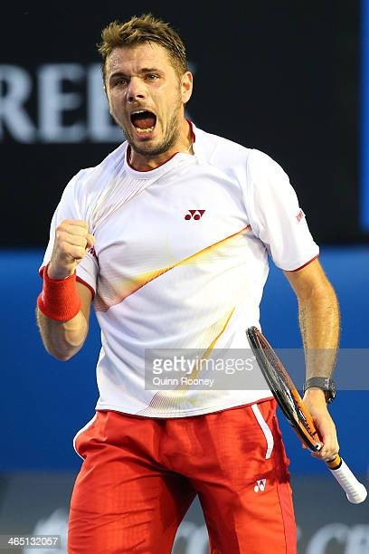 Stanislas Wawrinka of Switzerland celebrates winning the first set in his men's final match against Rafael Nadal of Spain during day 14 of the 2014...