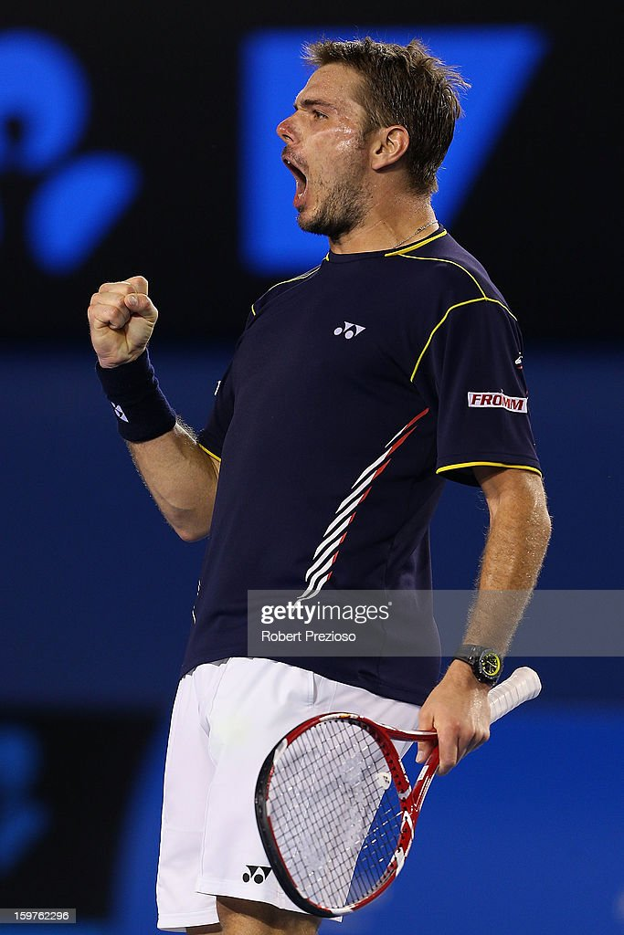 Stanislas Wawrinka of Switzerland celebrates winning the fourth set in his fourth round match against Novak Djokovic of Serbia during day seven of the 2013 Australian Open at Melbourne Park on January 20, 2013 in Melbourne, Australia.