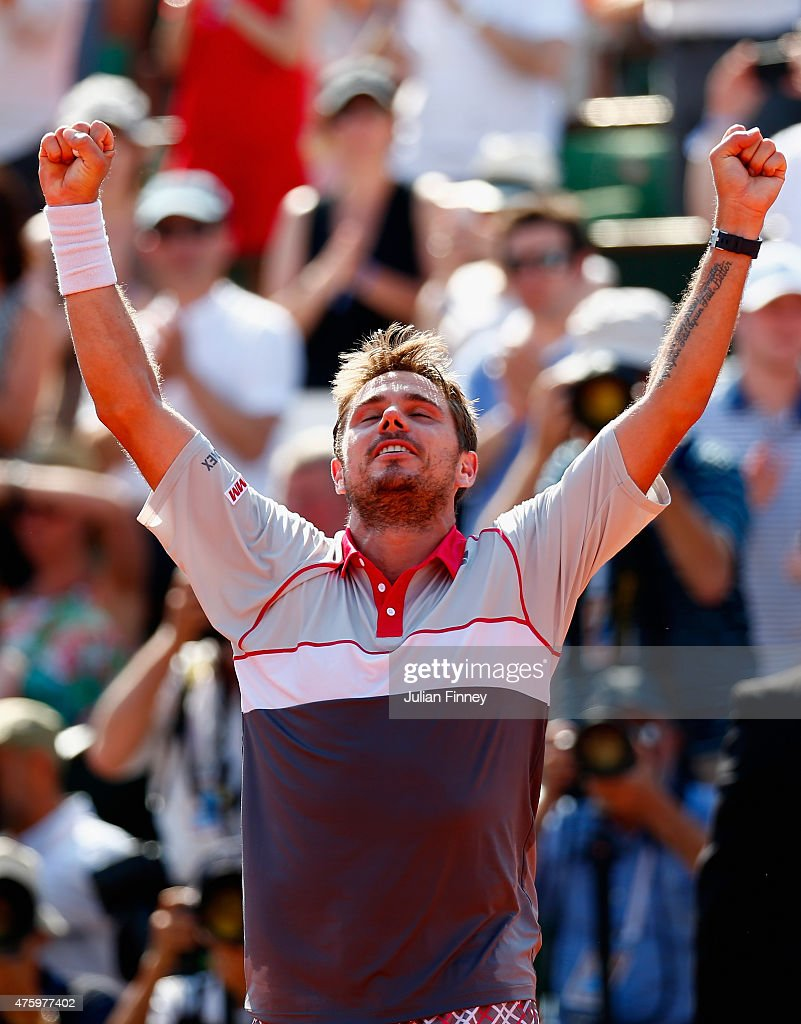 Stanislas Wawrinka of Switzerland celebrates winning the Men's Semi Final against JoWilfried Tsonga of France on day thirteen of the 2015 French Open...