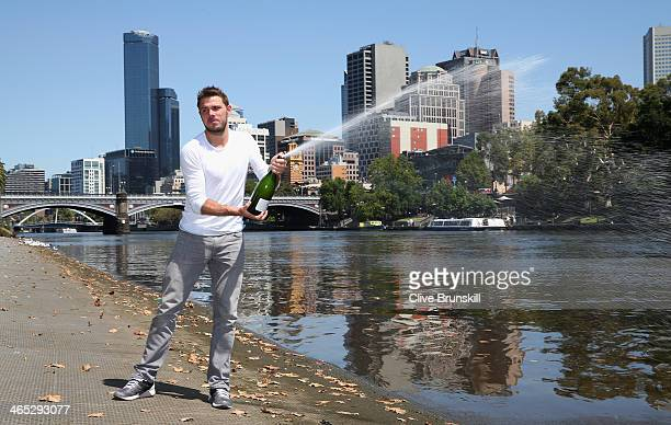 Stanislas Wawrinka of Switzerland celebrates with champagne at Melbourne University Boat Club after winning the 2014 Australian Open on January 27...