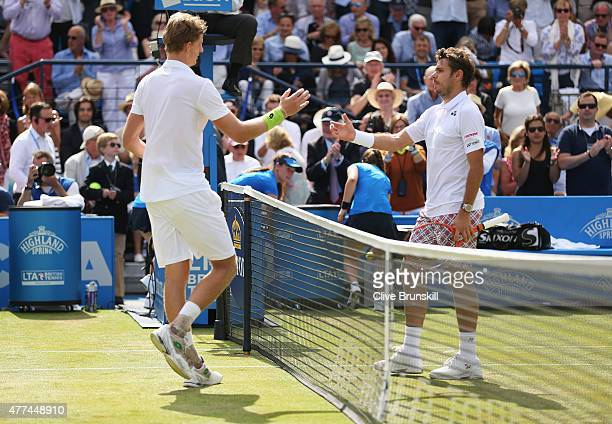 Stanislas Wawrinka of Switzerland congratulates winner Kevin Anderson of South Africa after their men's singles second round match during day three...