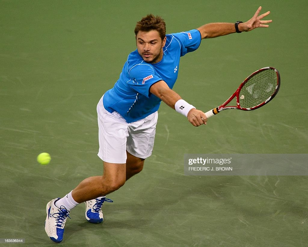 Stanislas Wawrinka of Switzerland fields a return against Lleyton Hewitt of Australia during their WTA third round match at the BNP Paribas Open in Indian Wells, California on March 11, 2013. AFP PHOTO / Frederic J. BROWN