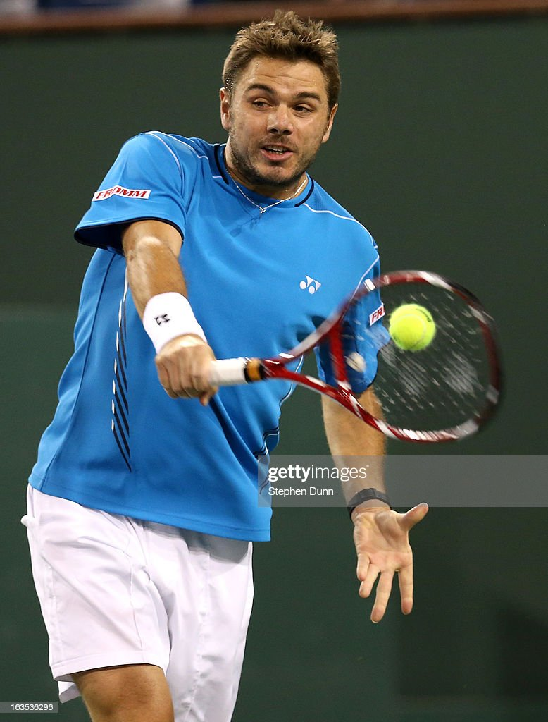 <a gi-track='captionPersonalityLinkClicked' href=/galleries/search?phrase=Stanislas+Wawrinka&family=editorial&specificpeople=557155 ng-click='$event.stopPropagation()'>Stanislas Wawrinka</a> of Switzerland hits a return to Lleyton Hewitt of Australia during day 6 of the BNP Paribas Open at Indian Wells Tennis Garden on March 11, 2013 in Indian Wells, California. (Photo by Stephen Dunn/Getty Images).