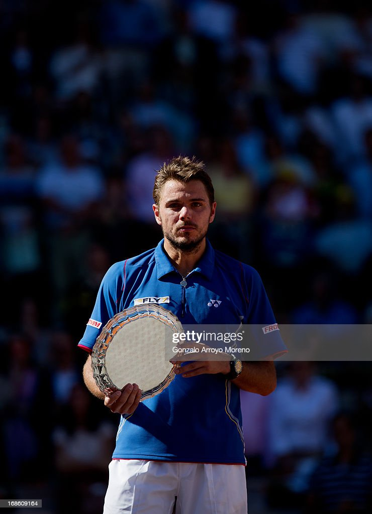 <a gi-track='captionPersonalityLinkClicked' href=/galleries/search?phrase=Stanislas+Wawrinka&family=editorial&specificpeople=557155 ng-click='$event.stopPropagation()'>Stanislas Wawrinka</a> of Switzerland hold his runner up trophy after loosing his final match against Rafael Nadal of Spain on day nine of the Mutua Madrid Open tennis tournament at the Caja Magica on May 12, 2013 in Madrid, Spain.