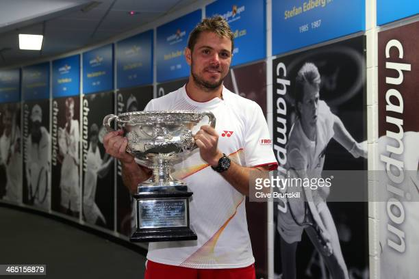 Stanislas Wawrinka of Switzerland holds the Norman Brookes Challenge Cup at the Walk of Champions after winning his men's final match against Rafael...