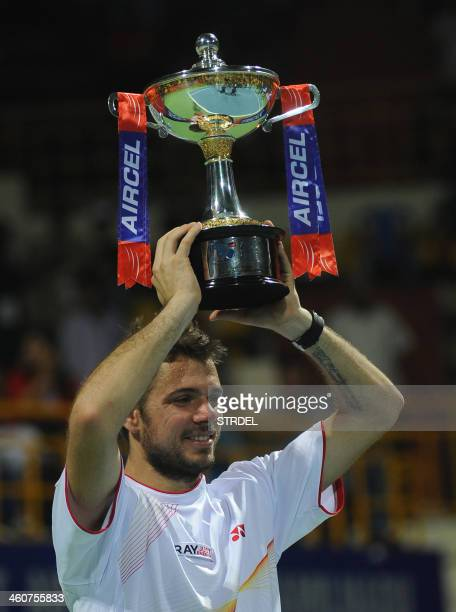 Stanislas Wawrinka of Switzerland holds the tournament trophy after winning the tennis final match at the Chennai Open in Chennai on January 5 2014...