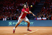 Stanislas Wawrinka of Switzerland in action against JoWilfried Tsonga of France line up before the first match during day one of the Davis Cup Tennis...