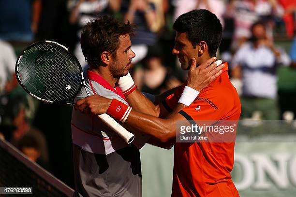 Stanislas Wawrinka of Switzerland is congratulated by Novak Djokovic of Serbia after victory in their Men's Singles Final on day fifteen of the 2015...