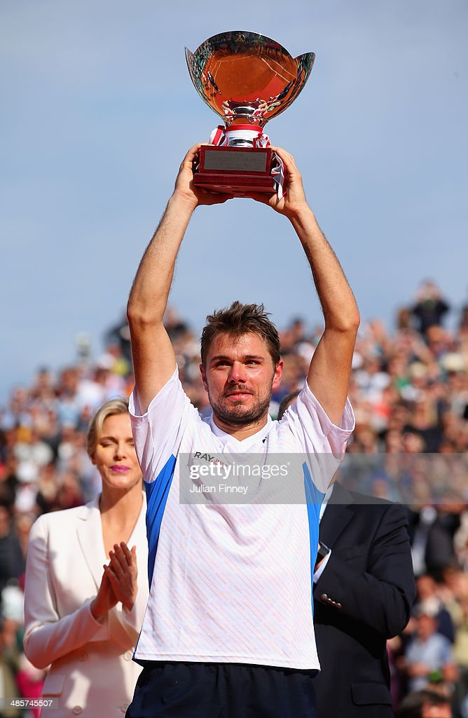 <a gi-track='captionPersonalityLinkClicked' href=/galleries/search?phrase=Stanislas+Wawrinka&family=editorial&specificpeople=557155 ng-click='$event.stopPropagation()'>Stanislas Wawrinka</a> of Switzerland lifts the winners trophy against Roger Federer of Switzerland in the final during day eight of the ATP Monte Carlo Rolex Masters Tennis at Monte-Carlo Sporting Club on April 20, 2014 in Monte-Carlo, Monaco.