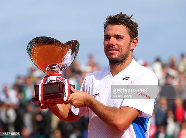 Stanislas Wawrinka of Switzerland lifts the winners trophy against Roger Federer of Switzerland in the final during day eight of the ATP Monte Carlo...
