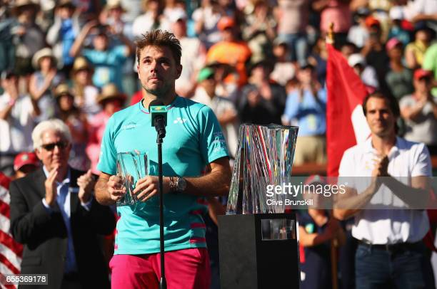 Stanislas Wawrinka of Switzerland makes his runners up speach after his straight sets defeat by Roger Federer of Switzerland in the mens final during...