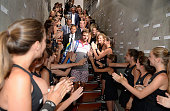 Stanislas Wawrinka of Switzerland makes his way through a ball kid guard of honour to his changing room after victory the Men's Singles Final against...