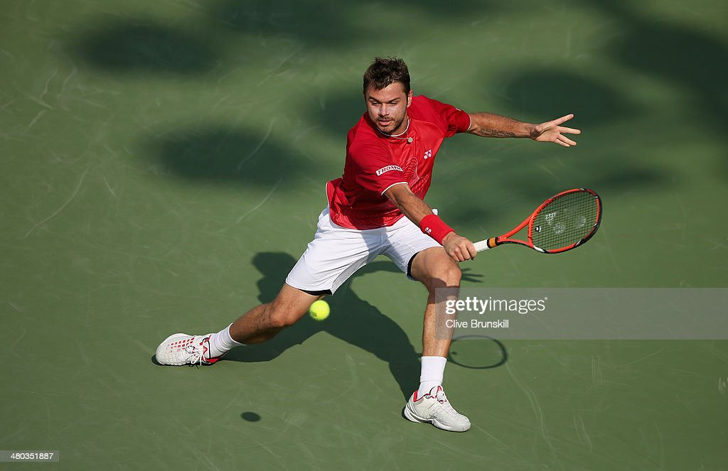 <a gi-track='captionPersonalityLinkClicked' href=/galleries/search?phrase=Stanislas+Wawrinka&family=editorial&specificpeople=557155 ng-click='$event.stopPropagation()'>Stanislas Wawrinka</a> of Switzerland plays a backhand against Edouard Roger-Vasselin of France during their third round match during day 8 at the Sony Open at Crandon Park Tennis Center on March 24, 2014 in Key Biscayne, Florida.
